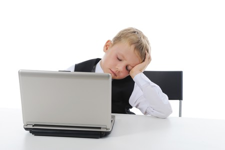 boy fell asleep at the computer. Isolated on white background Stock Photo - 7701612