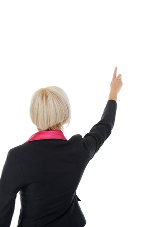 Businesswoman points finger up. Isolated on white background photo