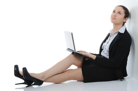 Businesswoman with laptop. Isolated on white background Stock Photo - 7701671