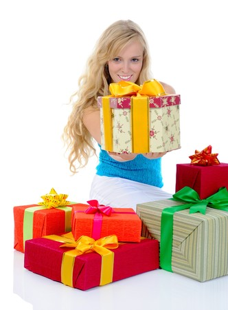 Blonde woman with gifts. Isolated on white background Stock Photo - 7799304