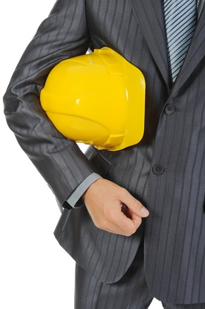 Businessman with construction yellow helmet. Isolated on white Stock Photo - 7799331
