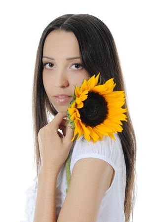 brunette with a sunflower. Isolated on white background photo