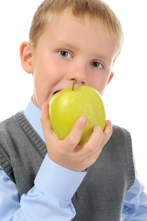 Boy eats an apple. Isolated on white background photo