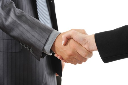 Handshake two business partners. Isolated on white background photo