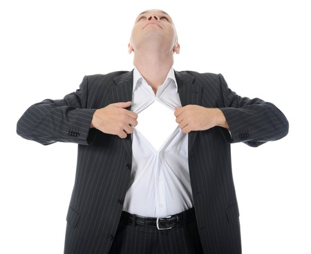 businessman tears open his shirt. Isolated on white background Stock Photo - 7799270