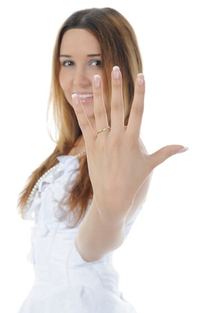 young bride shows ring. Isolated on white background photo