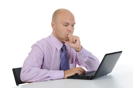 Frustrated man in front of laptop. Isolated on white background Stock Photo - 7799267