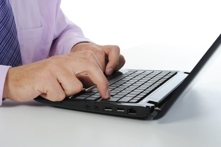 Hand on the laptop keyboard. Isolated on white background Stock Photo - 7799284