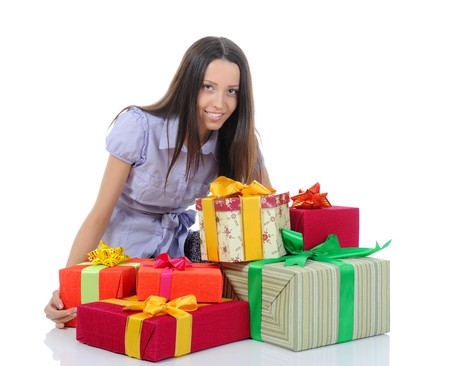 young woman with gifts. Isolated on white background photo