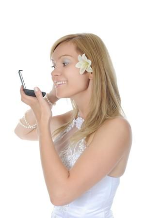 young bride dye eyelashes. Isolated on white background photo