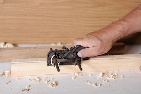 Master handles pine board a iron plane Stock Photo - 7799480