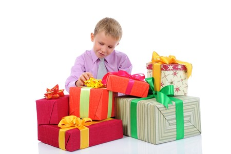 little boy with gifts. Isolated on white background photo