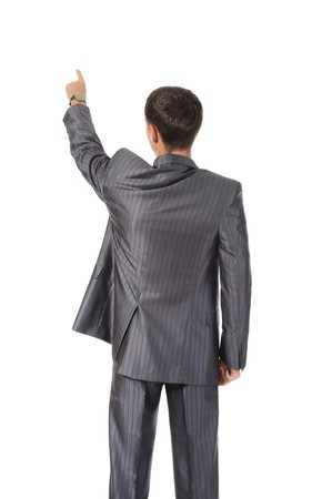 Businessman points finger up. Isolated on white photo