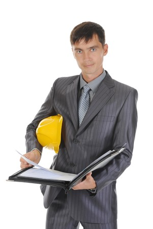 Businessman with construction helmet. Isolated on white photo