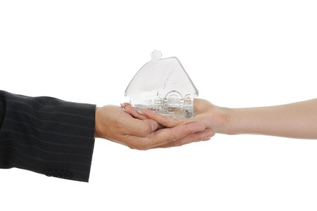 House in the hands. Isolated on white background Stock Photo - 7799386