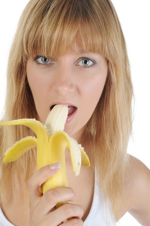 blonde girl with a banana. Isolated on white photo