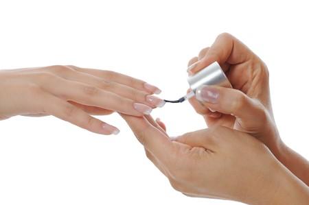 Girls paint nails. Isolated on white background photo