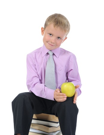 little boy with apple. Isolated on white background photo