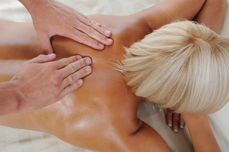Young tanned woman in the massage procedure photo