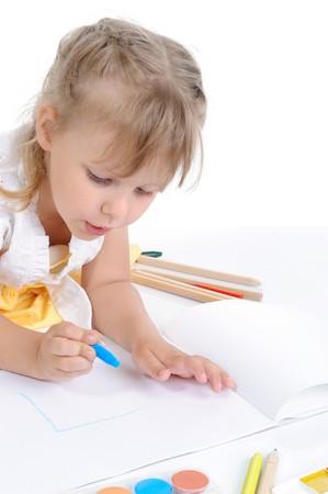 Girl draws on the album. Isolated on white Stock Photo - 7799683