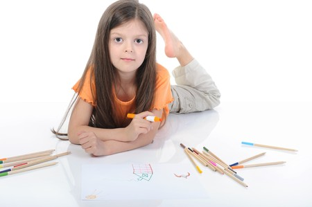 beautiful girl draws pencils. Isolated on white background photo