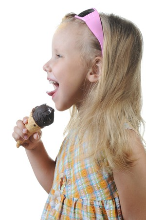 child eating ice cream. Isolated on a white Stock Photo - 7799741
