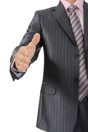 Businessman holds out his hand for a handshake. Isolated on white photo