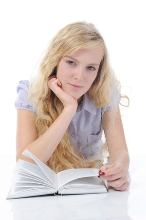young woman reading book. Isolated on white photo