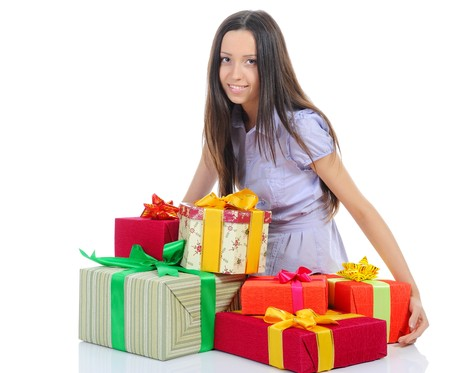 young woman with gift box. Isolated on white background photo