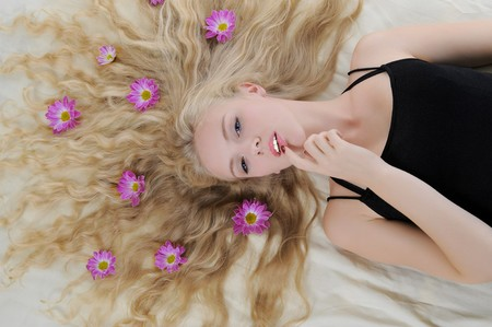 Long-haired blonde with flowers in their hair photo