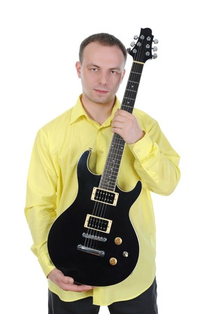 Young man with a black guitar. Isolated on white background photo