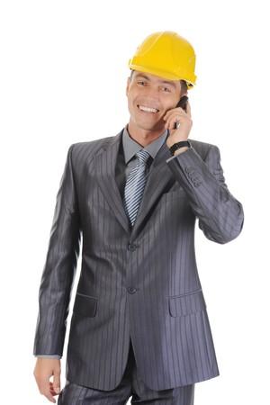 Happy businessman talking on the phone. Isolated on white background photo
