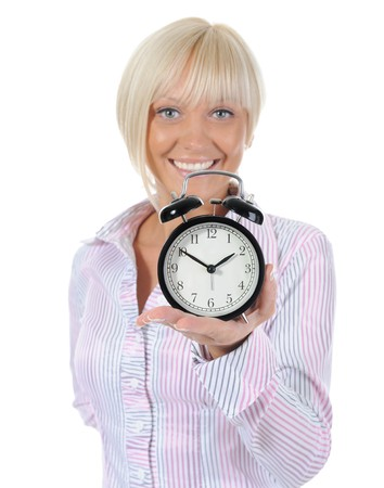 Young woman with an alarm clock in a hand. Isolated on white background photo