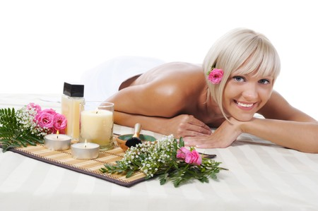 Young blonde girl at spa procedure Isolated on white background photo