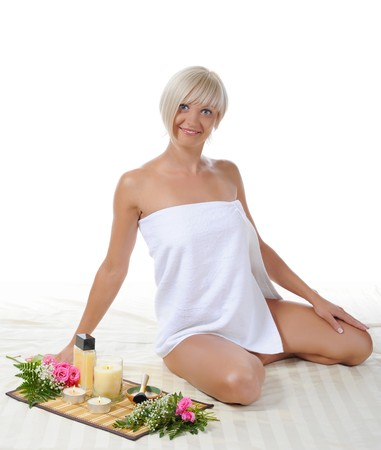 Young blonde woman at spa procedure Isolated on white background photo