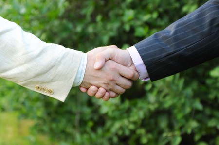 Handshake of men in black and white suits Stock Photo - 7799860