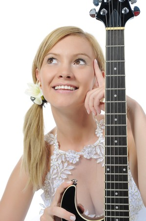 Smiling woman with guitar. Isolated on white background photo