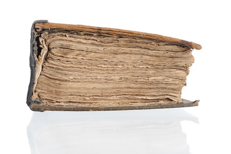 Old closed Bible. Isolated on white background photo