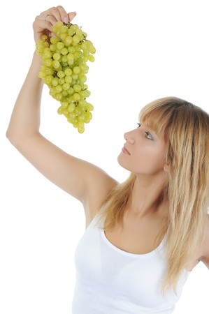 young blonde girl eating grapes. Isolated on white photo