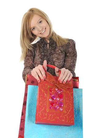 Happy women with shopping bags. Isolated on white background photo