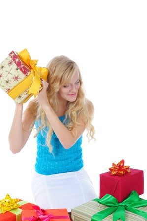Blonde woman with gifts. Isolated on white background photo