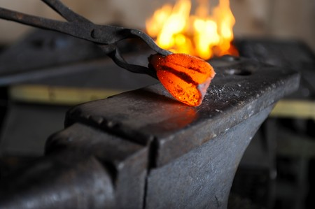 forge: Incandescent element in the smithy on the anvil