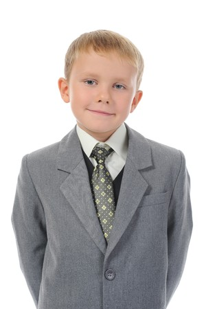 Little boy in a business suit. Isolated on white background photo