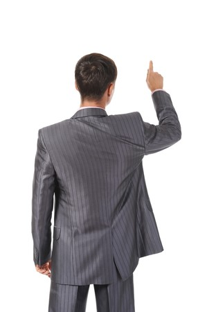Businessman points finger up. Isolated on white background Stock Photo - 7799923