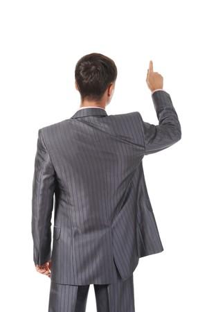 Businessman points finger up. Isolated on white background photo
