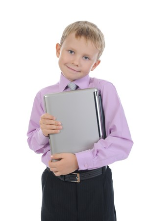 Happy little boy with laptop. Isolated on white background photo