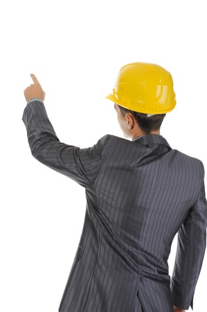 Businessman in helmet points finger up. Isolated on white background Stock Photo - 7799943