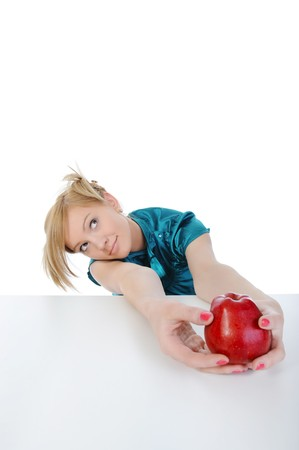 young woman with an apple in his hand. Isolated on white background Stock Photo - 7799873