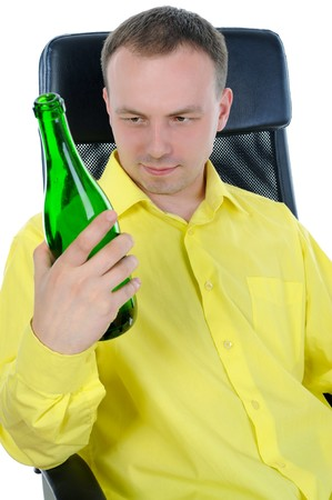 man drinking alcohol. Isolated on white background photo