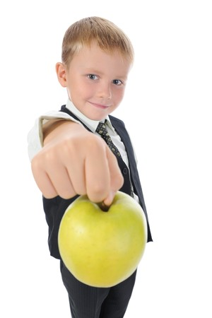 boy holds out an apple. Isolated on white background photo